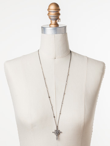 Celestial Cross Pendant in Antique Silver-tone Crystal displayed on a necklace bust