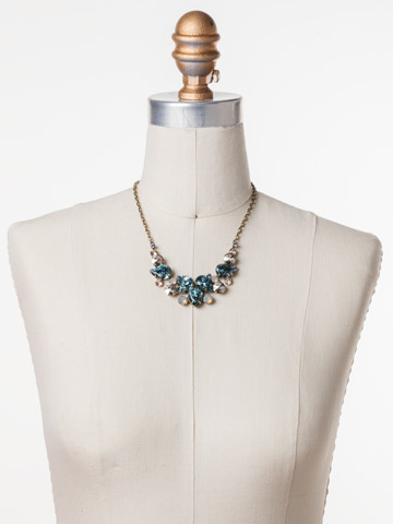 Nested Pear Statement Necklace in Antique Gold-tone Coastal Mist displayed on a necklace bust