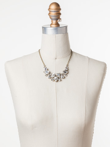 Nested Pear Statement Necklace in Antique Gold-tone Crystal displayed on a necklace bust