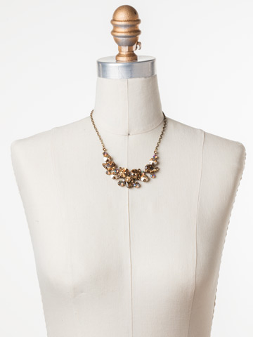 Nested Pear Statement Necklace in Antique Gold-tone Neutral Territory displayed on a necklace bust