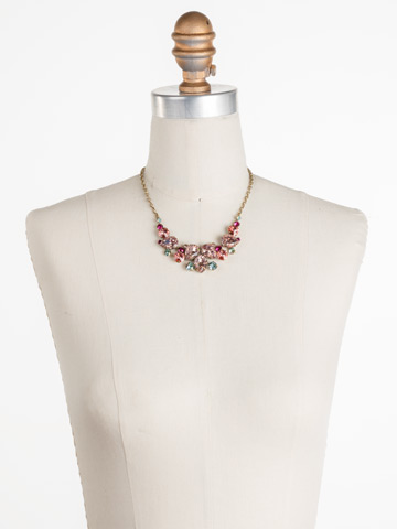 Nested Pear Statement Necklace in Antique Gold-tone Radiant Sunrise displayed on a necklace bust
