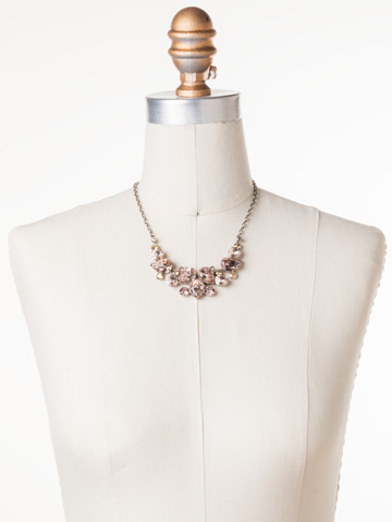 Nested Pear Statement Necklace in Antique Silver-tone Satin Blush displayed on a necklace bust