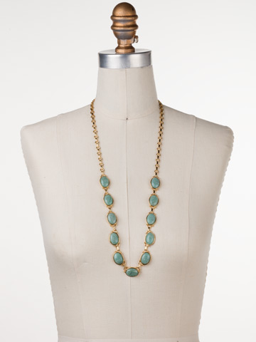 Large Eyelet Long Strand Necklace in Bright Gold-tone Pacific Opal displayed on a necklace bust