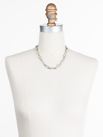 In Bloom Line Necklace in Antique Gold-tone Crystal displayed on a necklace bust