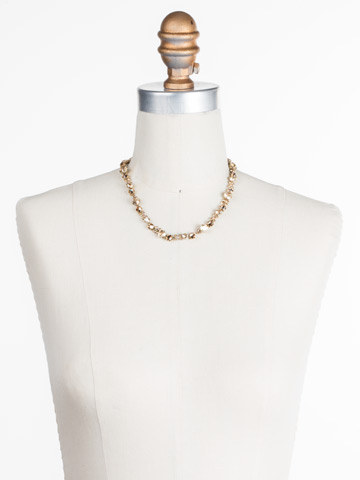In Bloom Line Necklace in Antique Gold-tone Neutral Territory displayed on a necklace bust