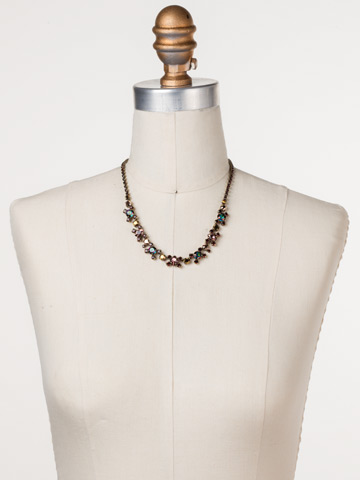 Perfect Harmony Line Necklace in Antique Gold-tone Mahogany displayed on a necklace bust