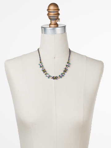 Perfect Harmony Line Necklace in Antique Gold-tone Wildflower displayed on a necklace bust