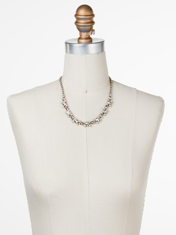 Perfect Harmony Line Necklace in Antique Gold-tone White Magnolia displayed on a necklace bust
