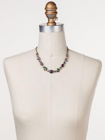 Embellished Elegance Necklace in Antique Gold-tone Jewel Tone displayed on a necklace bust