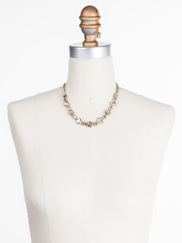 Embellished Elegance Necklace in Antique Gold-tone Neutral Territory displayed on a necklace bust