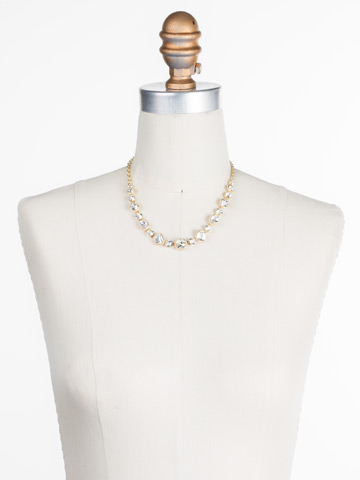 Embellished Elegance Necklace in Bright Gold-tone Crystal displayed on a necklace bust