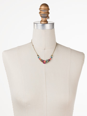 Asymmetric Cluster Necklace in Antique Gold-tone Botanical Brights displayed on a necklace bust