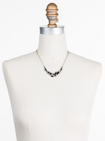 Asymmetric Cluster Necklace in Antique Silver-tone Black Onyx displayed on a necklace bust