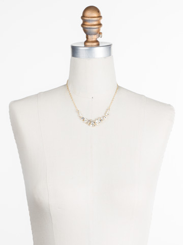 Asymmetric Cluster Necklace in Bright Gold-tone Crystal displayed on a necklace bust