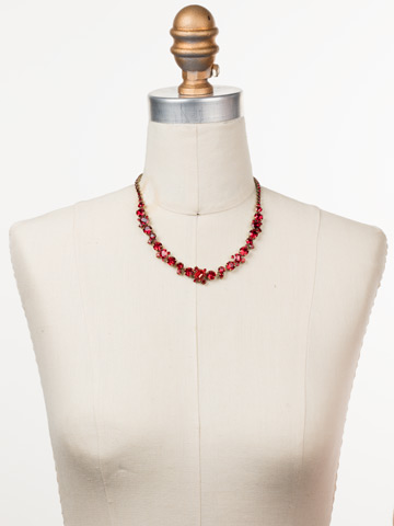 Sophisticate Classic Line Necklace in Antique Gold-tone Sansa Red displayed on a necklace bust