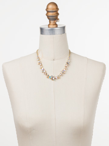 Sophisticate Classic Line Necklace in Bright Gold-tone Silky Clouds displayed on a necklace bust