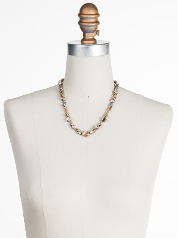 Multi-cut classic T-shirt Necklace in Antique Gold-tone Apricot Agate displayed on a necklace bust