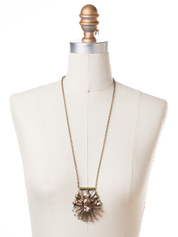 Radiant Gems Statement Pendant in Antique Gold-tone Apricot Agate displayed on a necklace bust