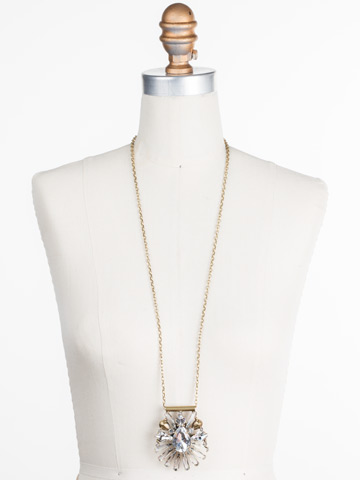 Radiant Gems Statement Pendant in Antique Gold-tone Crystal displayed on a necklace bust