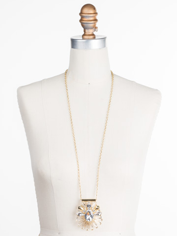 Radiant Gems Statement Pendant in Bright Gold-tone Crystal displayed on a necklace bust