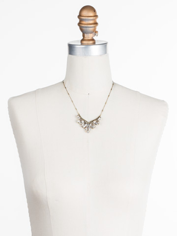 To the Point Necklace in Antique Gold-tone Crystal displayed on a necklace bust