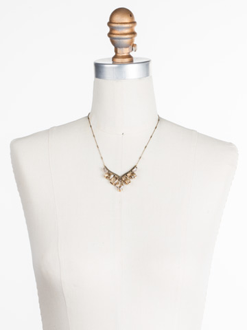 To the Point Necklace in Antique Gold-tone Neutral Territory displayed on a necklace bust