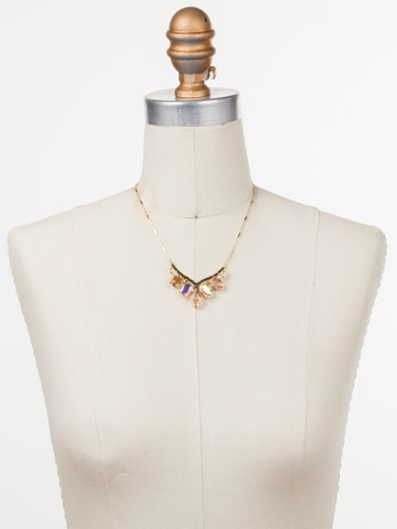 To the Point Necklace in Bright Gold-tone Silky Clouds displayed on a necklace bust