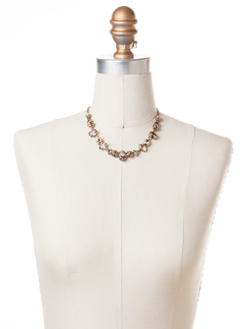 Socialite Statement Necklace in Antique Gold-tone Apricot Agate displayed on a necklace bust