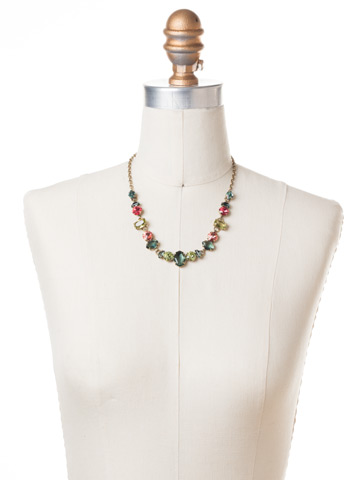 Socialite Statement Necklace in Antique Gold-tone Gem Pop displayed on a necklace bust