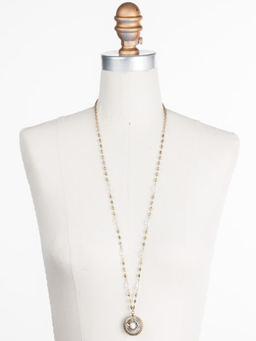 Majestic Medallion Pendant in Antique Gold-tone Crystal displayed on a necklace bust