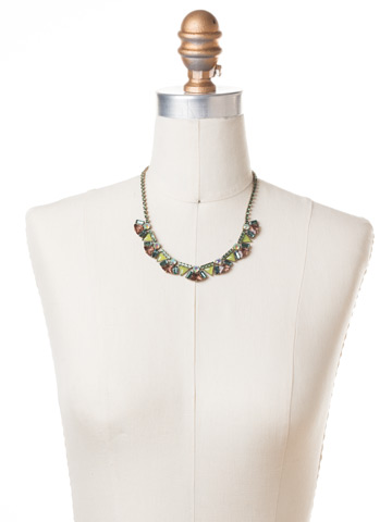 Mosaic Line Necklace in Antique Gold-tone Gem Pop displayed on a necklace bust