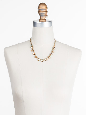 Simply Sophisticated Line Necklace in Antique Gold-tone Neutral Territory displayed on a necklace bust