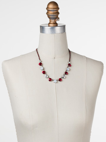 Simply Sophisticated Line Necklace in Antique Silver-tone Crimson Pride displayed on a necklace bust