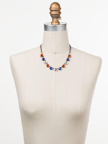 Simply Sophisticated Line Necklace in Antique Silver-tone Orange Crush displayed on a necklace bust
