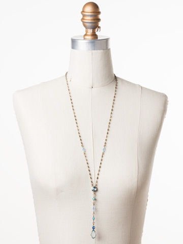 Regal Rhombus Y Necklace in Antique Gold-tone Azure Allure displayed on a necklace bust
