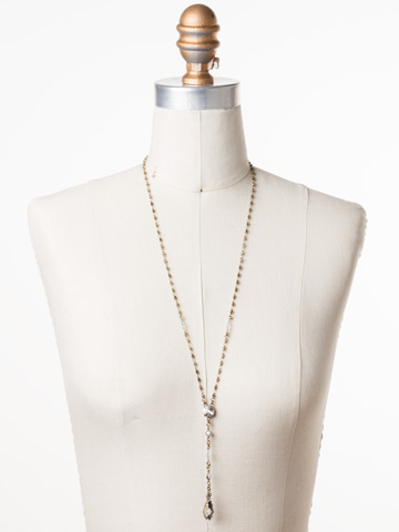 Regal Rhombus Y Necklace in Antique Gold-tone Crystal displayed on a necklace bust