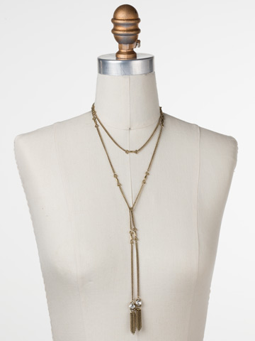 All Tied Up Necklace in Antique Gold-tone Crystal displayed on a necklace bust