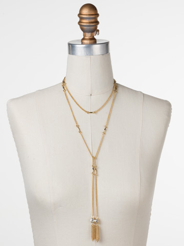 All Tied Up Necklace in Bright Gold-tone Crystal displayed on a necklace bust