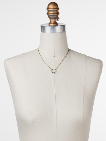 Haute Hammered Necklace in Antique Gold-tone Crystal displayed on a necklace bust