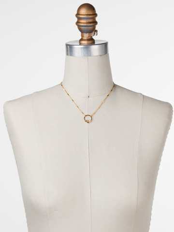 Haute Hammered Necklace in Bright Gold-tone Crystal displayed on a necklace bust