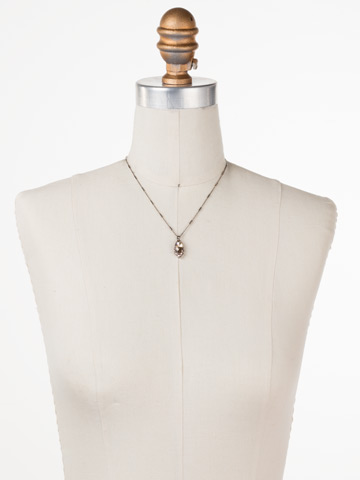 Ellis Necklace in Antique Silver-tone Satin Blush displayed on a necklace bust