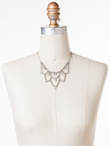 Interlacing Crystal Bib Necklace in Antique Silver-tone White Bridal displayed on a necklace bust
