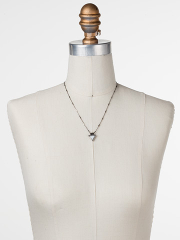 Triple Stack Pendant Necklace in Antique Silver-tone White Howlite displayed on a necklace bust