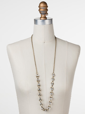 Tri Again Crystal Necklace in Antique Gold-tone Crystal displayed on a necklace bust
