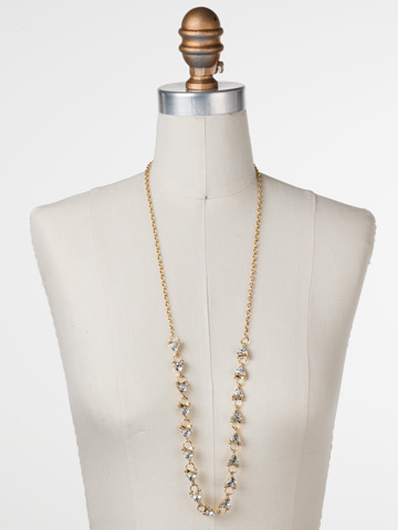 Tri Again Crystal Necklace in Bright Gold-tone Crystal displayed on a necklace bust