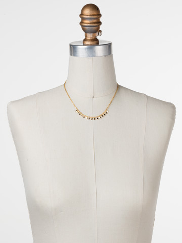 Mini Medallions Necklace in Bright Gold-tone Crystal displayed on a necklace bust