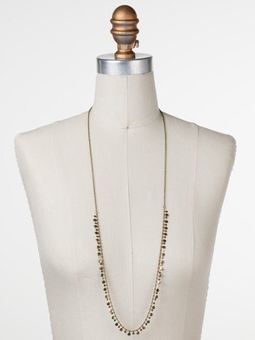 Long Mini Medallions Necklace in Antique Gold-tone Crystal displayed on a necklace bust