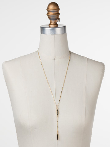 Point It Out Necklace in Bright Gold-tone Crystal displayed on a necklace bust