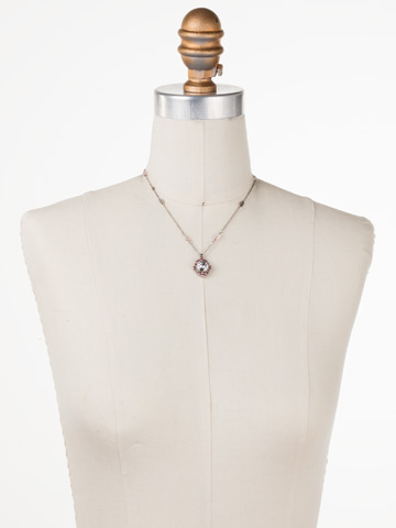 Runaround Necklace in Antique Silver-tone Crystal Rose displayed on a necklace bust