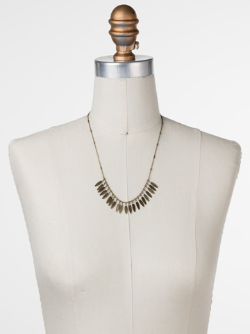 Feathered Fringe Necklace in Antique Gold-tone Crystal displayed on a necklace bust